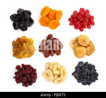 Set of dried fruits isolated on white background. Top view. Flat lay. - Stock Photo
