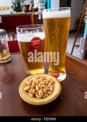 Portugal, Lisbon, Alfama, Old Town, Rua dos Remedios, glasses of Super Bock beer and peanut snack in small local bar - Stock Photo