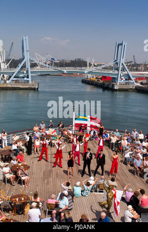 Portugal, Porto, Matosinhos, Leixoes, MV Marco Polo passengers being entertained on deck in sunshine - Stock Photo