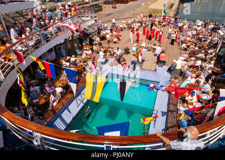 Portugal, Porto, Matosinhos, Leixoes, MV Marco Polo passengers being entertained on deck in sunshine - Stock Photo
