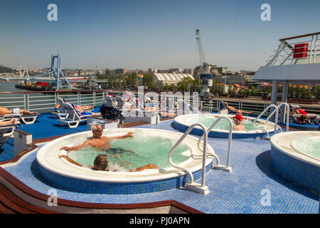 Portugal, Porto, Matosinhos, Leixoes Harbour, MV Marco Polo, passengers in jacuzzis of MV Marco Polo in sunshine - Stock Photo