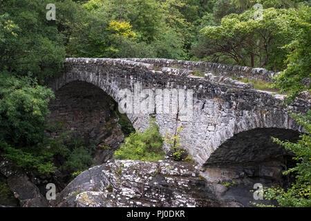Invermoriston Bridge, Highland, Scotland, August 2018. Historic Bridge over the River Moriston at Invermoriston, designed by Thomas Telford. - Stock Photo