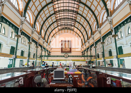 Ho Chi Minh City, Vietnam - April 30, 2018: Saigon Central Post Office hall (with a portrait of Ho Chi Minh). - Stock Photo