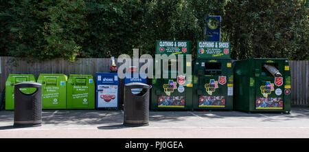 Reading, United Kingdom - August 06 2018:   Charity Recycling bins in the car park of Napier Road Tesco, including shoes, Books, DVDs, Clothes, given  - Stock Photo