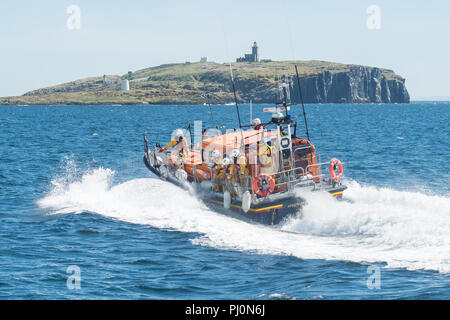 RNLI Lifeboat 'Kingdom of Fife' on an emergency call out from Anstruther Lifeboat Station, Fife, Scotland to an injured visitor on the Isle of May - Stock Photo