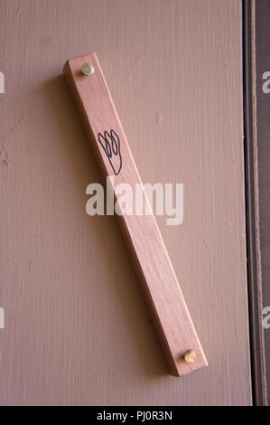 Close up of a mezuza on a doorpost - Stock Photo