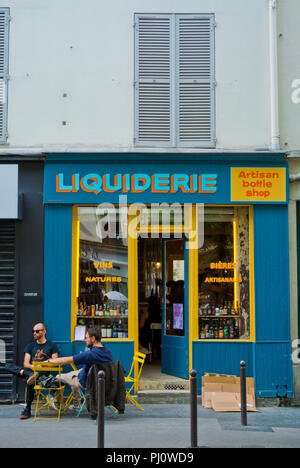 Bottle shop, shop selling beer and wine, Rue Jean-Pierre Timbaud, Oberkampf, Paris, France - Stock Photo
