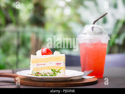 closeup of delicious homemade strawberry cake with leaf and fruit on top of bakery and strawberry juice for drink on table with blur background copy s - Stock Photo