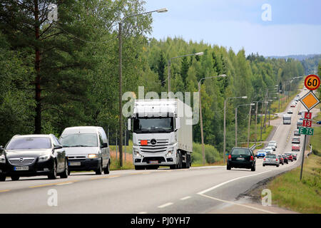Highway traffic with focus on white truck on an overcast day of summer on Finnish National Road 4 in Jyvaskyla, Finland - August 26, 2018. - Stock Photo