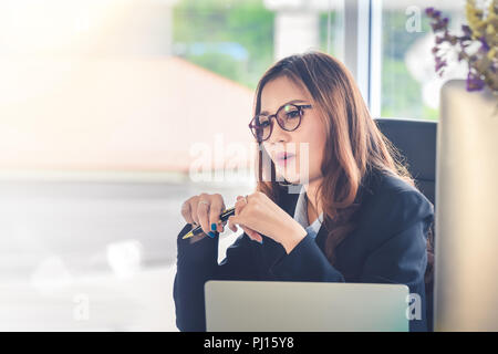 Businesswoman sitting in office desk ,Concept for Committee hiring manager to interview finalists - Stock Photo