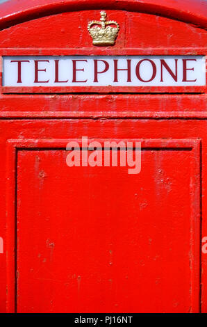 Detail of a British red public telephone box - Stock Photo