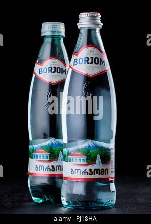 LONDON, UK - SEPTEMBER 03, 2018 : Bottles of Borjomi sparkling mineral water on blackn background.BORJOMI is born in Georgia. - Stock Photo