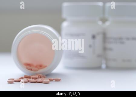 Prescription medicine in white bottle - Stock Photo