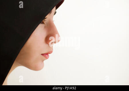 Portrait of a girl wearing a hood - Stock Photo