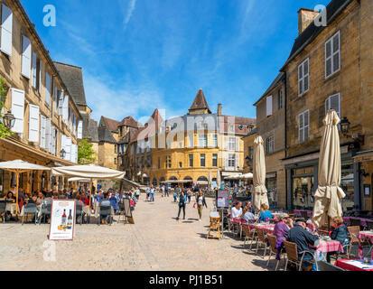 Cafes on Place de la Liberté in the old town, Sarlat, Dordogne, France - Stock Photo