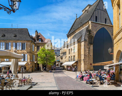 Cafes on Place de la Liberte looking towards Old St. Mary's Church, Sarlat, Dordogne, France - Stock Photo