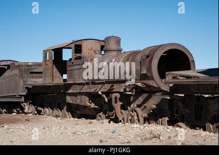 Rusty old and abandoned train at the Cementerio de Trenes in Uyuni desert, Bolivia - South America - Stock Photo