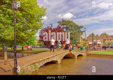 Cotswolds village Bourton on the Water and the River Windrush in Gloucestershire, England, UK. - Stock Photo