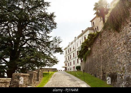 Pavement road to villa in Conegliano, Italy - Stock Photo