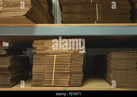 Paper bags arranged in rack - Stock Photo