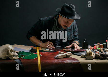 Working process of making shoes in workshop. - Stock Photo