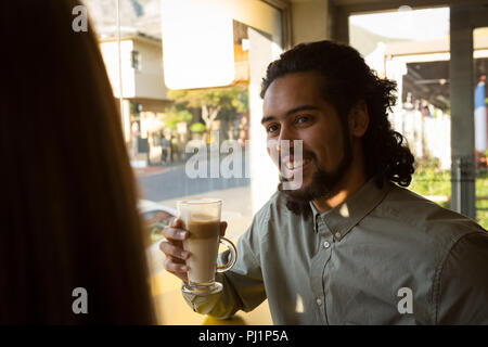 Man having coffee in cafe - Stock Photo