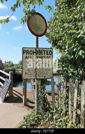 A sign prohibiting certain vehicles from crossing the bridge at Flatford Mill, Flatford Road, East Bergholt, Colchester, UK - Stock Photo