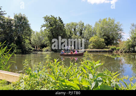 People in a rowing boat on the River Stour at Flatford, Flatford Road, East Bergholt, Colchester, UK - Stock Photo