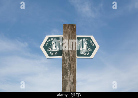 Sign post directing people on the Severn Way Path isolated against a blue sky - Stock Photo