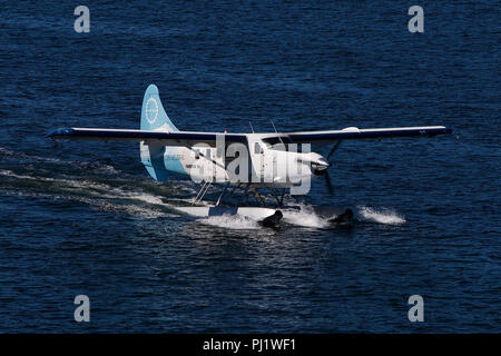 De Havilland Canada DHC-3T Otter (C-GHAS) operated by Harbour Air with the Fly Carbon Neutral Livery, Vancouver Harbor, Vancouver, British Columbia, Canada - Stock Photo