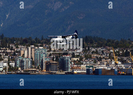 De Havilland Canada DHC-3T Otter (C-GHAZ) operated by Harbour Air with the Vancouver Whitecaps Livery lands in Vancouver Harbor, Vancouver, British Columbia, Canada - Stock Photo