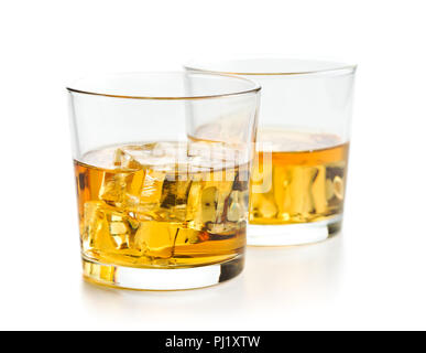 Glass of alcoholic drink with ice cubes isolated on white background. Whiskey in glass. - Stock Photo