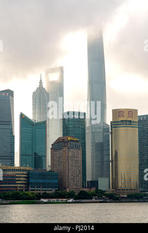 Morning light rays on downtown Pudong skyline from the Bund in Shanghai, China. - Stock Photo