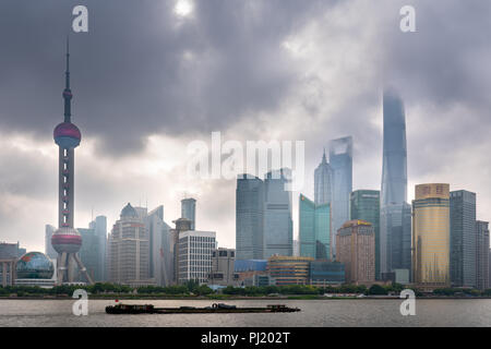 Pudong Skyline in the morning from the Bund in Shanghai, China. - Stock Photo