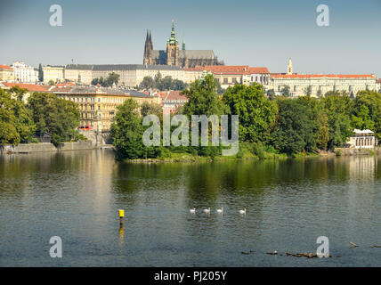Scenic view of the River Vltava with Prague Castle and St Vitas Cathedral in the background - Stock Photo
