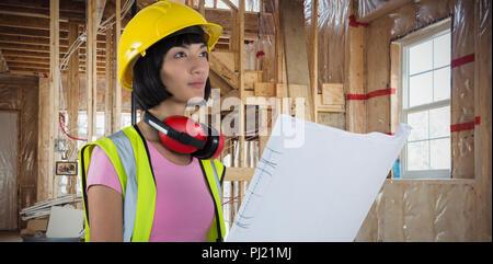 Composite image of female architect holding blueprint against white background - Stock Photo