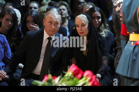 Russian President Vladimir Putin sits with Ninel Kobzon, widow of legendary Russian singer Iosif Kobzon, during his memorial service at Tchaikovsky Concert Hall September 2, 2018 in Moscow, Russia. Kobzon, known as the Soviet Sinatra, died aged 80 after a protracted battle with cancer.  (Photo by Russian Presidency via Planetpix) - Stock Photo