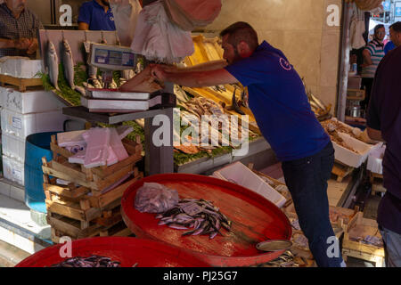 Istanbul, Turkey. 3rd September, 2018.  A fish seller is preparing for customers amid Turkey inflation rate hits Turkish markets. Credit: Engin Karaman/Alamy Live News - Stock Photo