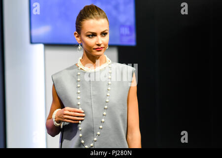London, UK. 3nd September, 2018. Model wearing Jewellery form stalls of the exhibitors showcases is latest brands and designers at the International Jewellery London 2018, Olympia London, UK. Credit: Picture Capital/Alamy Live News - Stock Photo