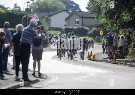 Honiton,  Devon, UK, 3rd September 2018. The Tour of Britain, Stage 2 Cranbrook to Barnstaple. The chasing peloton descends Church hill into Honition. Credit: David Partridge/Alamy Live News - Stock Photo