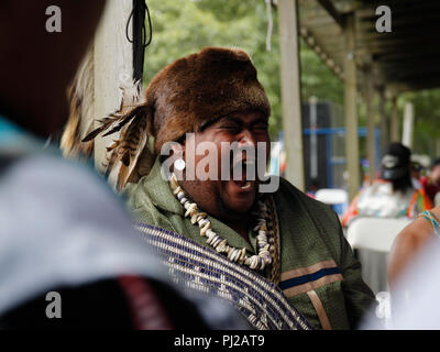 Southhampton, United States of America. 03rd, Sep 2018. A Native American singing with the group before the presentation to the ceremony 72nd annual Shinnecock Indian Powwow over the Labour Day weekend in Southampton Long Island New York in Southhampton, United States of America, 03 September 2018. (PHOTO) Alejandro Sala/Alamy News - Stock Photo