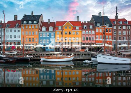 Nyhavn at sunrise in Copenhagen, Denmark. - Stock Photo