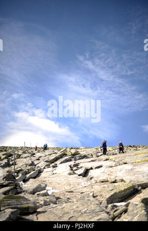 people going up to the mountain top on a sunny autumn day - Stock Photo