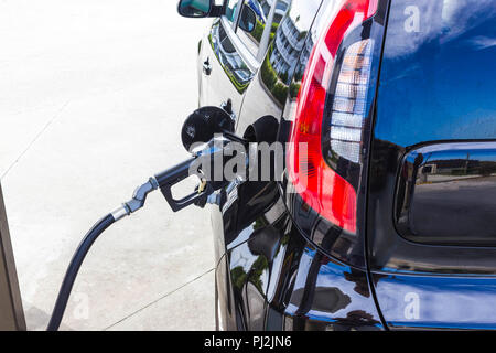 Car refueling on petrol station. Fuel pump with gasoline. - Stock Photo