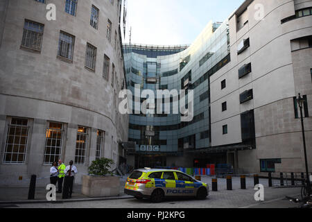 A police car outside of BBC Broadcasting House, on Portland Place, London, after reports of a specious vehicle outside the building. - Stock Photo
