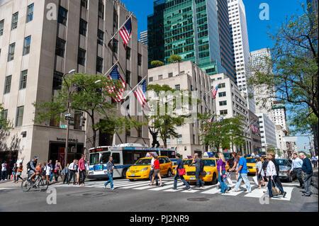 Busy city street crossing on Fifth Avenue, New York City, America, USA - Stock Photo