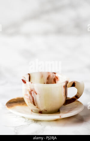 Coffee cup set with brown marble pattern on white - Stock Photo