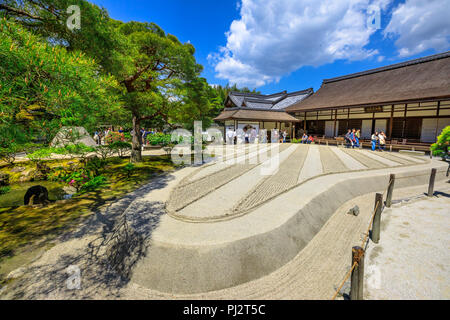 Kyoto, Japan - April 28, 2017: tourists around zen garden in Ginkakuji Temple. Ginshadan sand pattern representing the sea. Ginkaku-ji or Silver Pavilion, officially named Jisho-ji, is a Zen temple. - Stock Photo