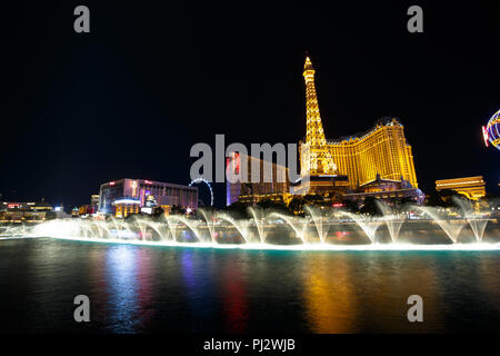 Bellagio fountain show at night on the Las Vegas Strip - Las Vegas, Nevada - Stock Photo