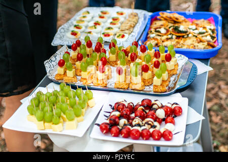 buffet Assortment of canapes. Banquet service. catering food, snacks with mixed fingerfood appetizers. - Stock Photo